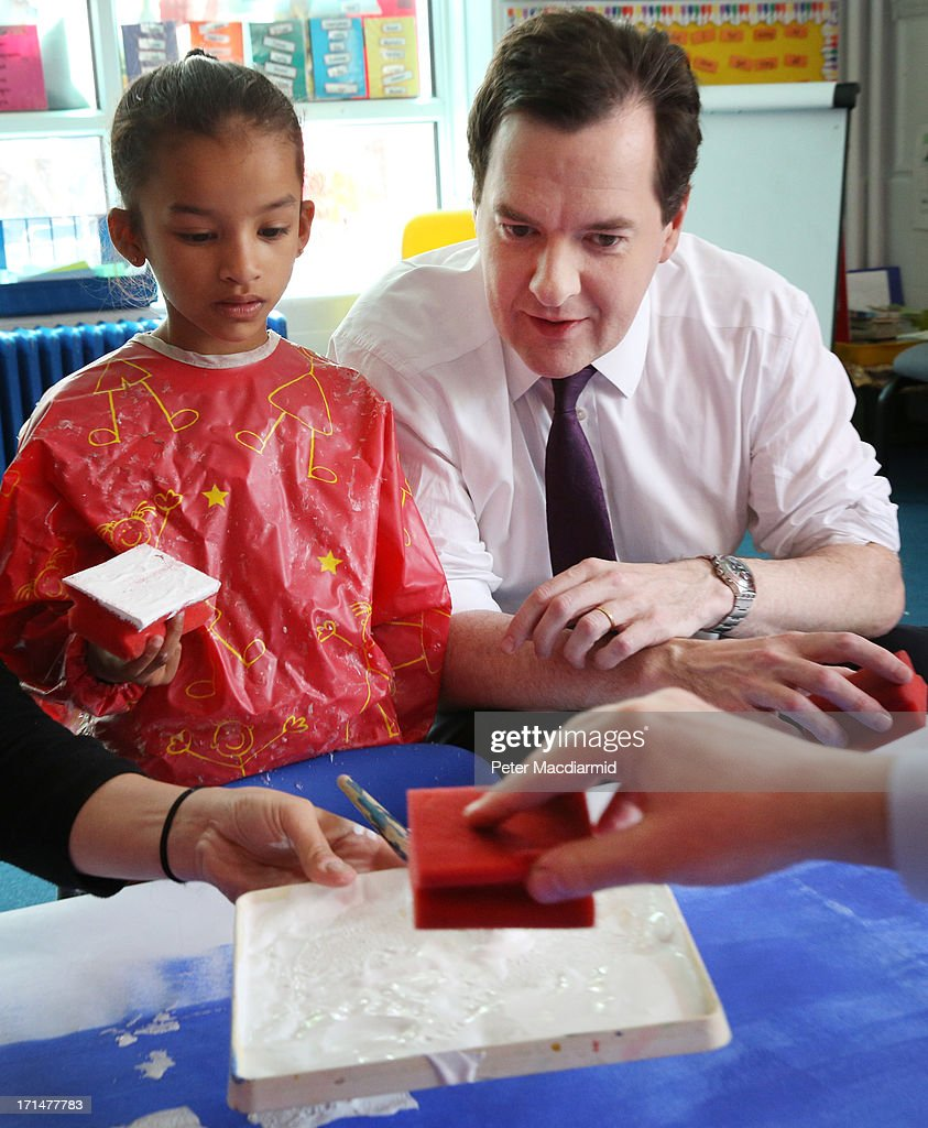 Chancellor of the Exchequer George Osborne watches as Education Secretary Michael Gove (not in shot) helps paint a picture of Canary Wharf during a visit to Old Ford Primary School on June 25, 2013 in London, England. Tomorrow Mr Osborne will announce the Government's spending review for 2015-1016. Earlier the Chancellor announced that spending on schools will be ring fenced.