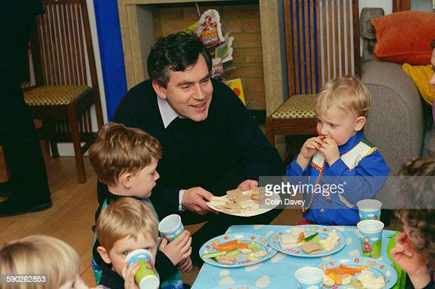 Chancellor of the Exchequer Gordon Brown at a birthday party for the son of his diary secretary Susan Nye UK 15th March 1998