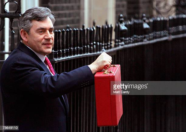Chancellor of the Exchequer Gordon Brown holds his ministerial red box as he leaves for Parliament to present his 11th budget statement on March 21...