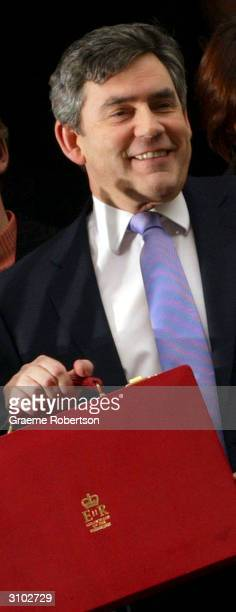 Chancellor of the Exchequer Gordon Brown holds the red dispatch box containing his budget before making his speech to the House of Commons on March...