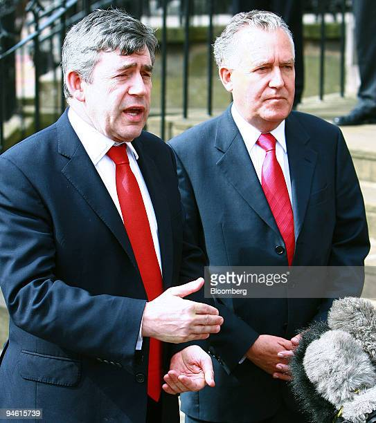 Chancellor of the Exchequer Gordon Brown left and Minister for Northern Ireland Peter Hain speak to the media outside the Scottish Office after...