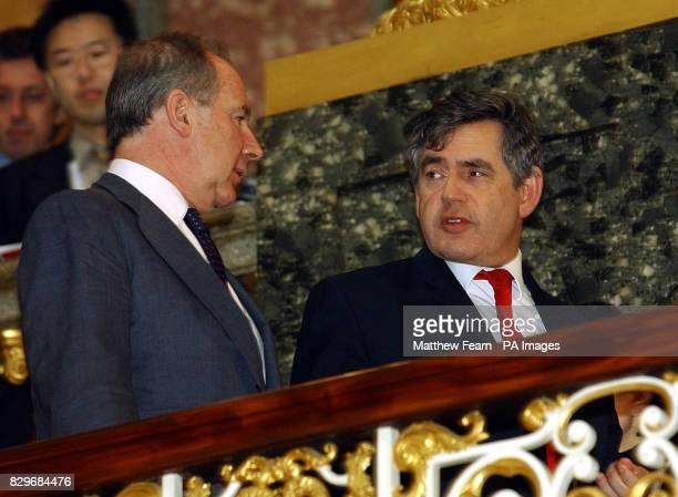 Chancellor of the Exchequer Gordon Brown speaks with International Monetary Fund Managing Director Rodrigo de Rato