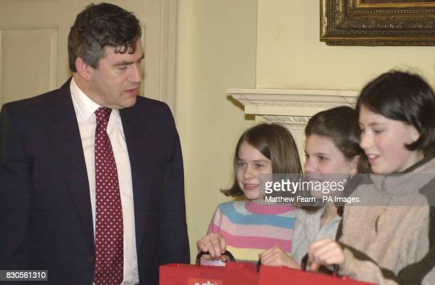 Chancellor of the Exchequer Gordon Brown with 11yearold Esme Anderson from Greenwich 11yearold Kate Harshall from Chatham 12yearold Lilly Thomas from...
