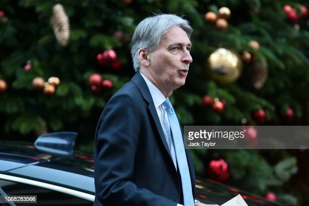 Chancellor of the Exchequer Philip Hammond arrives at 10 Downing Street as Ministers attend a weekly cabinet meeting ahead of a meaningful vote...