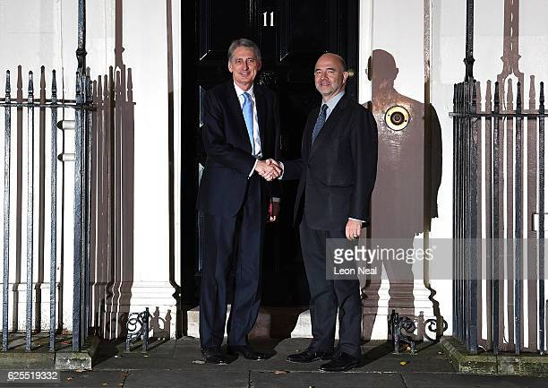 Chancellor of the Exchequer Philip Hammond greets Pierre Moscovici the European Commissioner for Economic and Financial Affairs at 11 Downing Street...