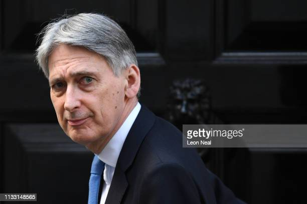 Chancellor of the Exchequer Philip Hammond leaves 11 Downing Street on March 27 2019 in London England MPs in the House of Commons will vote on...