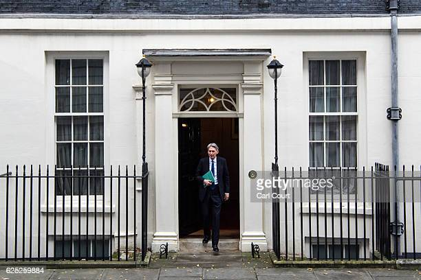 Chancellor of the Exchequer Philip Hammond leaves 11 Downing Street to deliver his Autumn Statement to Parliament on November 23 2016 in London...