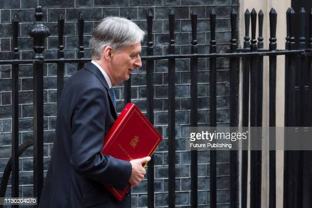 Chancellor of the Exchequer Philip Hammond leaves Downing Street in central London to announce the Spring Statement in the House of Commons March 13...