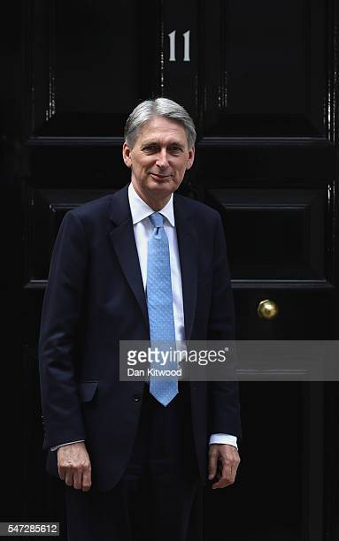 Chancellor of the Exchequer Philip Hammond poses outside 11 Downing Street after meeting with US Secretary of the Treasury Jacob Lew during his first...