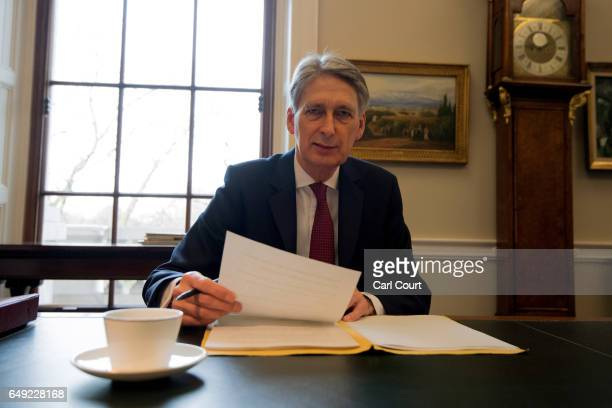 Chancellor of the Exchequer Philip Hammond prepares his speech in his office at the Treasury ahead of his 2017 budget annoucement on March 7 2017 in...