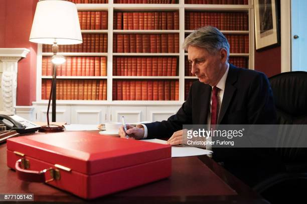 Chancellor of the Exchequer Philip Hammond prepares his speech in his office in Downing Street ahead of his 2017 budget announcement tomorrow on...