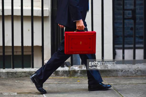 Chancellor of the Exchequer, Philip Hammond, presents the red Budget Box as he departs from 11 Downing Streets to make his way to the Parliament to...