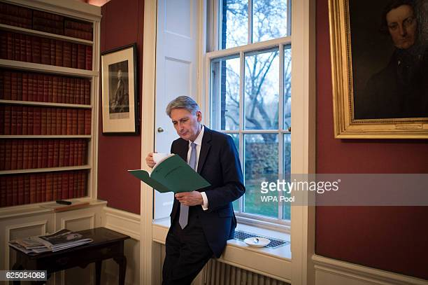 Chancellor of the Exchequer Philip Hammond reads through his Autumn Statement in his office in 11 Downing Street which he will deliver to MPs at the...