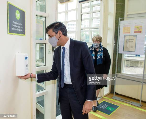 Chancellor of the Exchequer Rishi Sunak and Secretary of State for Work and Pensions Therese Coffey visit a Jobcentre Plus in Barking, east London to...