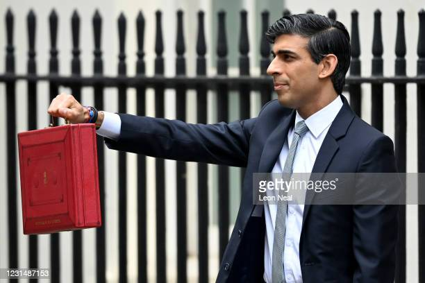 Chancellor of the Exchequer, Rishi Sunak, holds the budget box as he departs to deliver the annual Budget at 11 Downing Street on March 3, 2021 in...