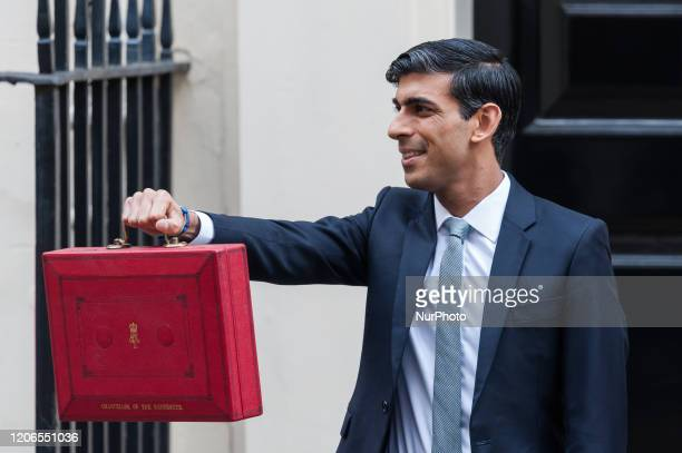 Chancellor of the Exchequer Rishi Sunak holds the budget box outside 11 Downing Street in central London ahead of the announcement of the Spring...