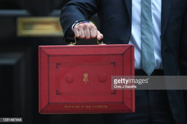 Chancellor Of The Exchequer, Rishi Sunak holds the red box as he stands outside 11 Downing Street ahead of the Chancellor of the Exchequer's delivery...