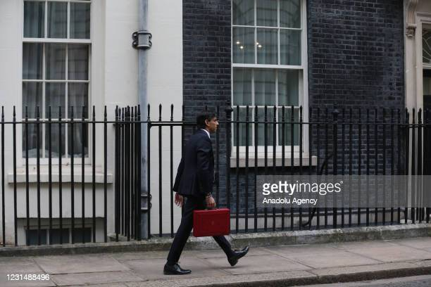 Chancellor of the Exchequer Rishi Sunak holds the red dispatch box before leaving 11 Downing Street to make the budget statement in the House of...