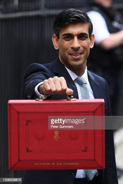Chancellor of the Exchequer Rishi Sunak holds up the Budget box as he presents the annual Budget at Downing Street on March 11 2020 in London England...
