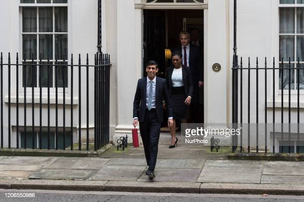 Chancellor of the Exchequer Rishi Sunak leaves 11 Downing Street in central London to announce the Spring Statement in the House of Commons on 11...