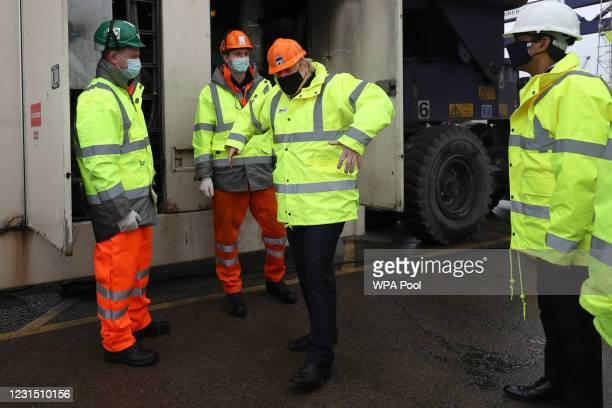 Chancellor of the Exchequer Rishi Sunak , looks towards British Prime Minister Boris Johnson during a visit to Teesport on March 4, 2021 in Teesport,...