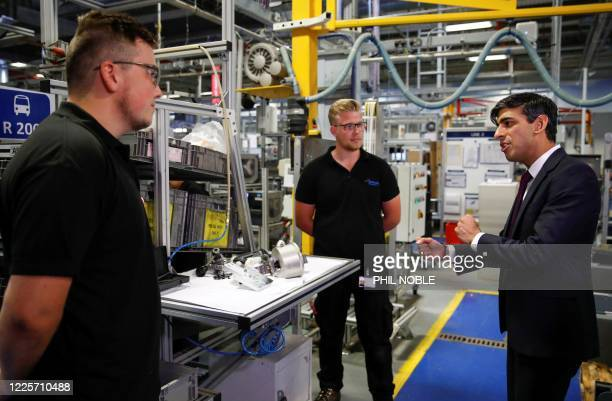 Chancellor of the Exchequer Rishi Sunak speaks to employees during a visit to the Worcester Bosch factory in Worcester, central England, on July 9,...