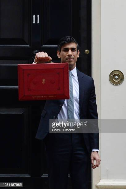 Chancellor Of The Exchequer, Rishi Sunak stands with the Budget Box outside 11 Downing Street ahead of the Chancellor of the Exchequer's delivery of...