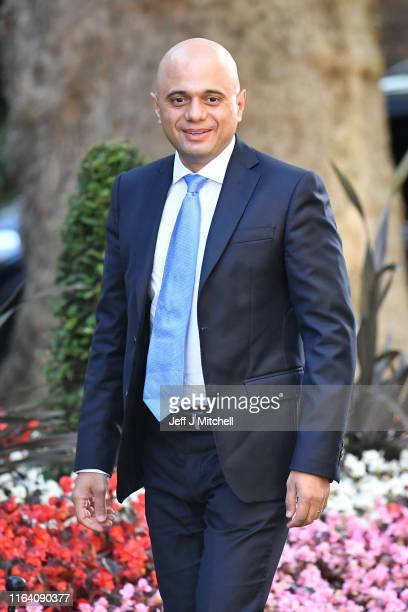 Chancellor of the Exchequer Sajid Javid and Northern Ireland Secretary Julian Smith arrive at 10 Downing Street on July 25 2019 in London England...