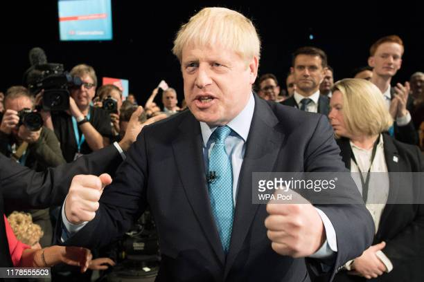 Chancellor of the Exchequer Sajid Javid congratulates Prime Minister Boris Johnson following his keynote speech on day four of the 2019 Conservative...