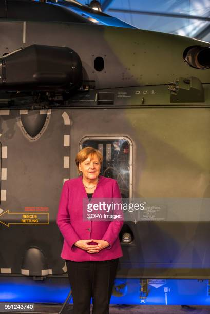 Chancellor of the Federal Republic of Germany Angela Merkel of the Christian Democratic Union stands in front of a military helicopter during the...