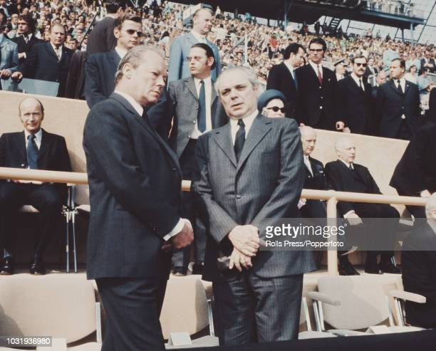 Chancellor of West Germany Willy Brandt pictured on left with Ben Horan Israel's Ambassador to West Germany during the memorial ceremony for the...