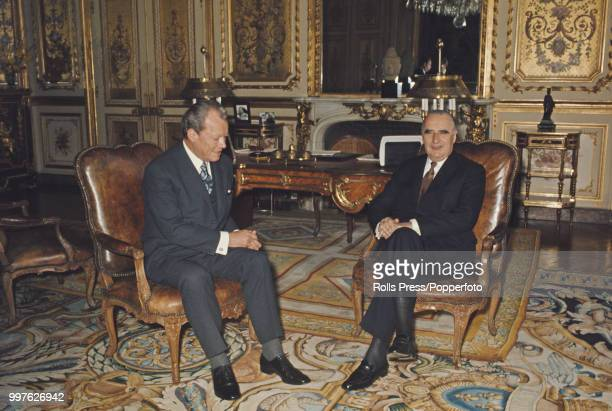 Chancellor of West Germany Willy Brandt pictured sitting together on left with French President Georges Pompidou in Pompidou's study at the Elysee...