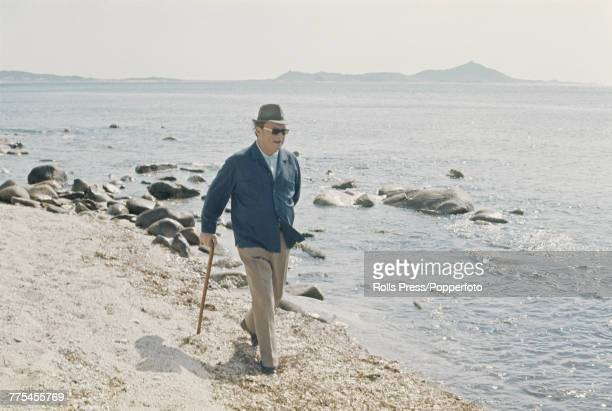Chancellor of West Germany Willy Brandt pictured walking along a beach at Capo Boi in Sardinia Italy during an Easter holiday on 5th April 1972