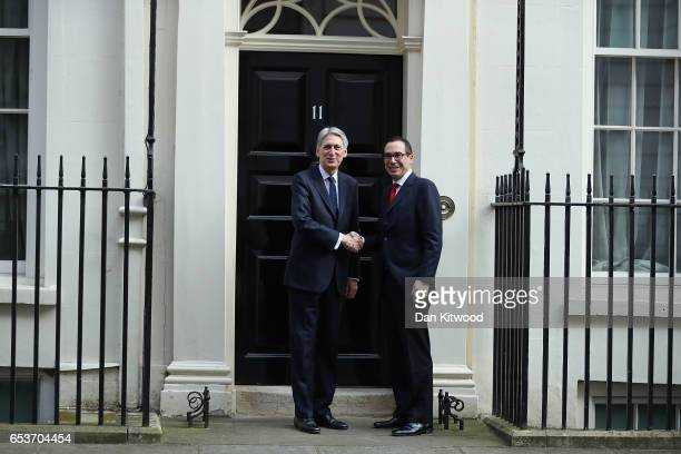 Chancellor Philip Hammond greets the US Secretary of the Treasury Steven Mnuchin to 11 Downing Street on March 16 2017 in London England The...