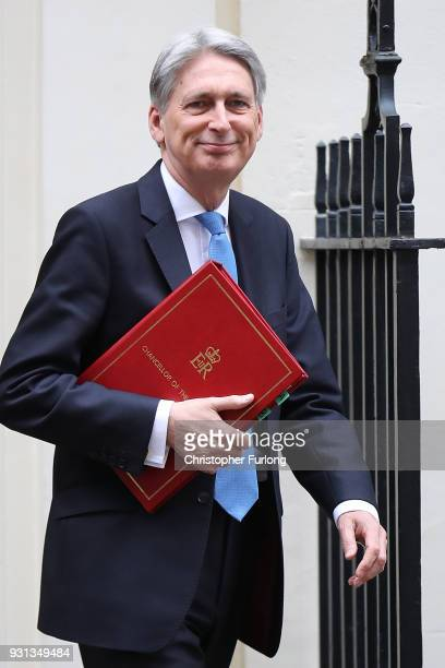 Chancellor Philip Hammond leaves number 11 Downing Street to present the Spring Statement in Parliament on March 13 2018 in London England