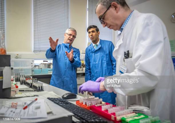 Chancellor Rishi Sunak is shown the testing of samples for respiratory viruses by Dr Antony Hale during a visit to the pathology labs at Leeds...
