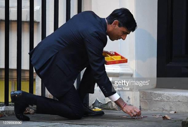 Chancellor Rishi Sunak lights a candle for Diwali in Downing Street on November 12, 2020 in London, England. The Hindu festival of lights takes place...