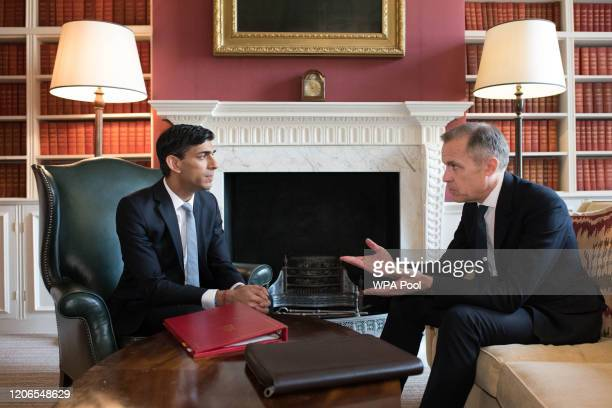 Chancellor Rishi Sunak meets with the Governor of the Bank of England Mark Carney in Downing Street before heading to the House of Commons to deliver...