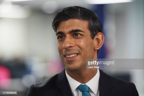 Chancellor Rishi Sunak speaks with members of staff as he visits the headquarters of Octopus Energy on October 05, 2020 in London, England. The prime...