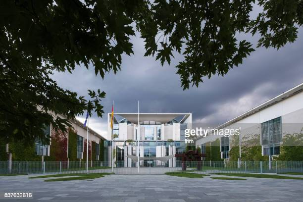 Chancellor's office with rain clouds, framed by a tree (Berlin, Germany)