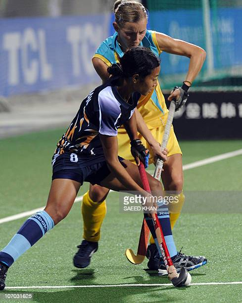 Chanchan Devo Thokchom of India vies for the ball against Vera Domashneva during the second half of the women's field hockey pool W match at the 16th...