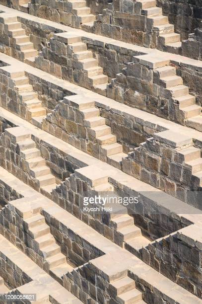 chand baori stepwell in the village of abhaneri, rajasthan, india - abhaneri stock pictures, royalty-free photos & images