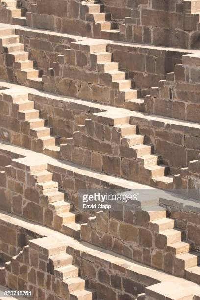 chand baori stepwell, rajasthan, india - abhaneri stock photos and pictures