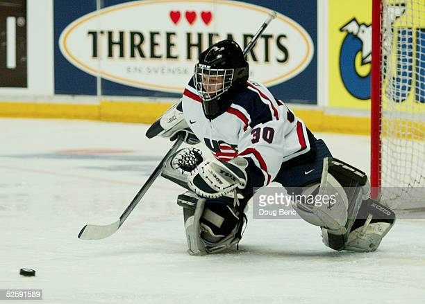 Chanda Gunn of Team USA dives on the puck to make a save against team Germany in a IIHF World Women's Championships preliminary game at the Cloetta...