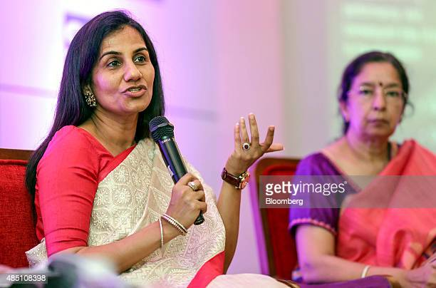 Chanda Kochhar managing director and chief executive officer of ICICI Bank Ltd left speaks whilst Shikha Sharma managing director and chief executive...