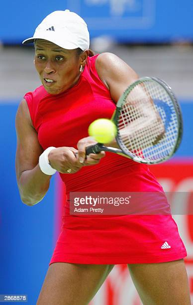 Chanda Rubin of the USA in action during her match against Justine Henin-Hardenne of Belgium during the Adidas International at Sydney International...
