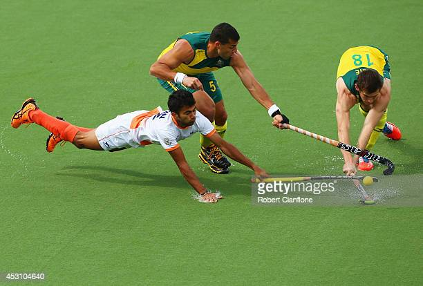 Chandanda Nikkin Thimmaiah of India battles with Chris Ciriello and Tristan White of Australia in the gold medal match between India and Australia at...