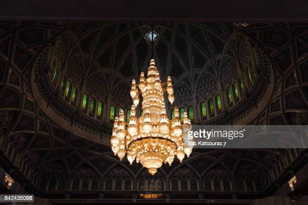 chandelier at the main praying hall of the sultan qaboos grand mosque - crystal mosque stock pictures, royalty-free photos & images