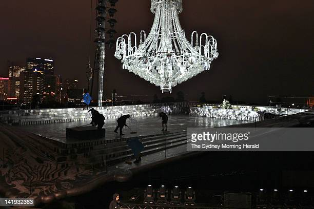 A chandelier containing 10000 Swarovski crystals is ferried across Sydney Harbour in preparation for Opera Australia's outdoor performance of Verdi's...