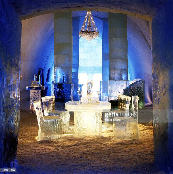 A chandelier hangs above a dining table at the Ice Hotel January 2002 in Jukkasjarvi Sweden The 30 000 square foot hotel is constructed anew every...